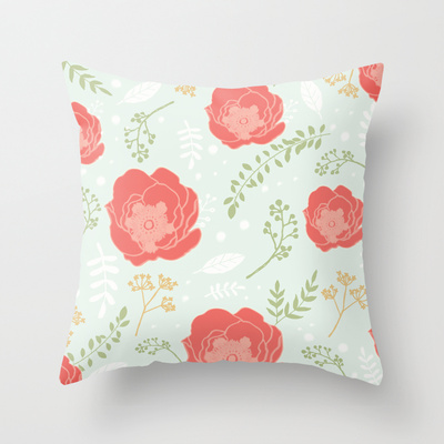 mint throw pillow with coral flowers