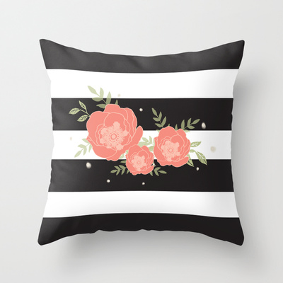 black and white striped pillow with coral flowers